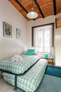 A bed or beds in a room at HSH Select Casa Alfalfa