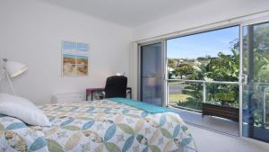 A bed or beds in a room at Kiama Dreamtime on Noorinan
