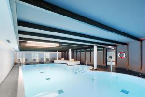 The swimming pool at or near Relais & Châteaux Landhaus Stricker
