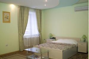 Кровать или кровати в номере Гостиничный Комплекс Солнечный