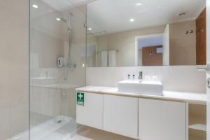 A bathroom at Spot Family Apartments