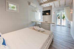Ένα ή περισσότερα κρεβάτια σε δωμάτιο στο The ELECTRA Premium Boutique Apartments