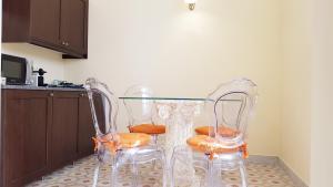 Télévision ou salle de divertissement dans l'établissement Residence San Mattia