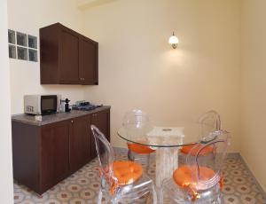 Cuisine ou kitchenette dans l'établissement Residence San Mattia