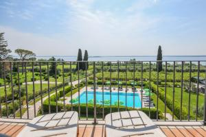 A view of the pool at Residence Corte Ferrari or nearby