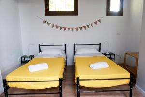 A bed or beds in a room at The Hostello