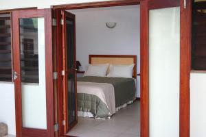 A bed or beds in a room at Bularangi Villa, Fiji