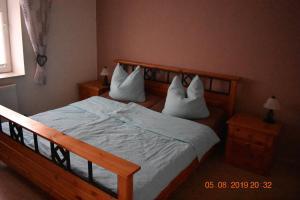 Ein Bett oder Betten in einem Zimmer der Unterkunft Ferienhaus Harzvorland