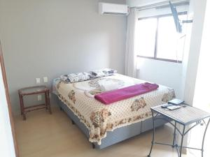 A bed or beds in a room at flat wall street