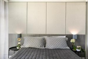 A bed or beds in a room at The Bowral Hotel