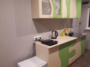 A kitchen or kitchenette at Адлер. Комната с удобствами.