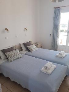 Säng eller sängar i ett rum på Elizabeth
