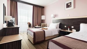 Кровать или кровати в номере Гостиница Измайлово Дельта