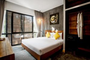 A bed or beds in a room at The Butterfly Pea