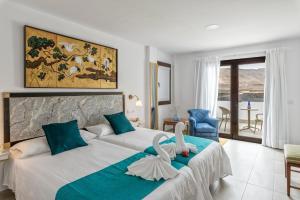 Een bed of bedden in een kamer bij La Casona de Yaiza