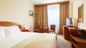 Кровать или кровати в номере Гостиница Измайлово Гамма