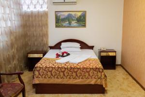 A bed or beds in a room at Vila Muntenia Hotel
