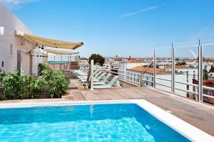 The swimming pool at or near Catalonia Santa Justa