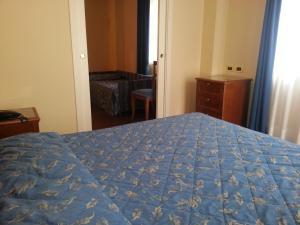 Letto o letti in una camera di Albergo Costantini