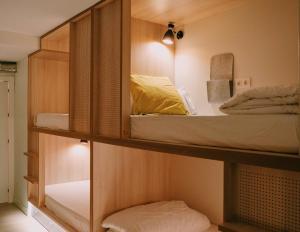 Litera o literas de una habitación en Blai Blai Hostel