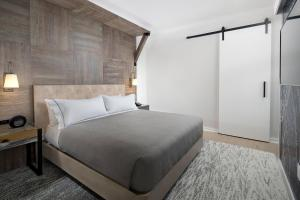 A bed or beds in a room at Canopy By Hilton Washington DC The Wharf