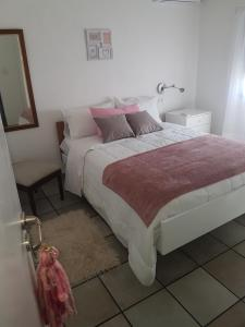 A bed or beds in a room at El Palomar Misiones 6574