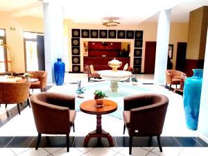 The lounge or bar area at Les Acacias Hotel Djibouti