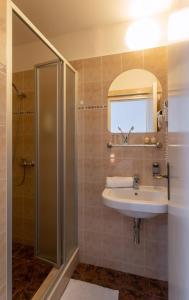Um banheiro em Novoměstský hotel