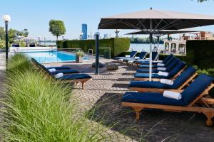 The swimming pool at or near Hilton Vienna Danube Waterfront