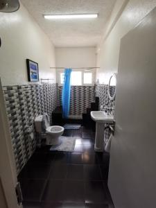 A bathroom at TD Guest House