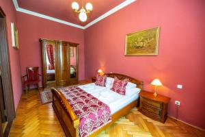 A bed or beds in a room at Grand Hotel Praha