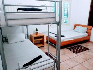 "A bunk bed or bunk beds in a room at Hostel ""Cyprus House"""