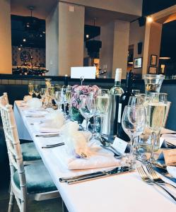 A restaurant or other place to eat at The George at Baldock Boutique Hotel