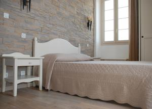 A bed or beds in a room at Marina D'oro