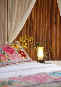 A bed or beds in a room at Hotel Zentik Project & Saline Cave