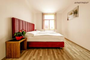 A bed or beds in a room at Hotel Otakar