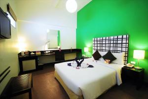 Cama o camas de una habitación en The Embassy Sathorn
