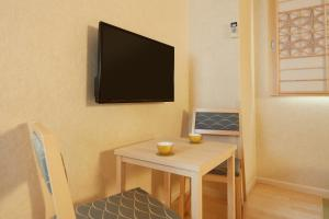 A television and/or entertainment center at HOTEL MYSTAYS Asakusabashi