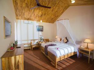 A bed or beds in a room at La Mer Resort
