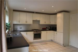 A kitchen or kitchenette at Darwin Place