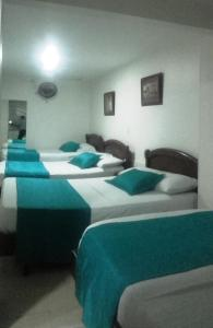 Cama o camas de una habitación en Hotel Center