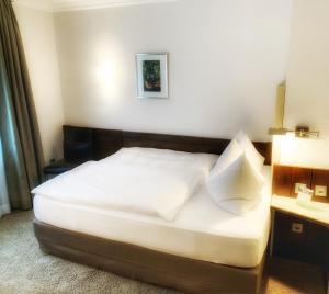 """Ein Bett oder Betten in einem Zimmer der Unterkunft Hotel Menge """"An der Schlacht"""""""