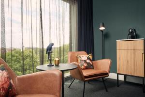 A seating area at Van der Valk Hotel Antwerpen