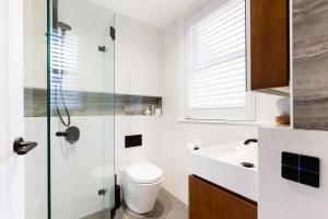 A bathroom at The Rocks Heritage to Designer Barangaroo Luxury