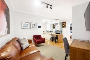 A seating area at The Rocks Heritage to Designer Barangaroo Luxury
