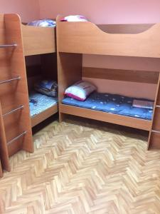 A bunk bed or bunk beds in a room at Подушка