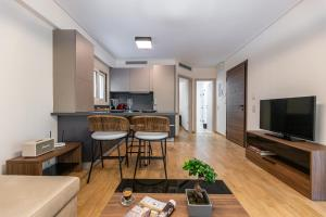 A television and/or entertainment centre at Olygreen Athens Residences