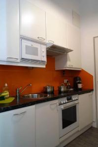 Kuchyň nebo kuchyňský kout v ubytování Vienna Apartment Gutarra II