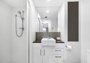 A bathroom at The Hill Apartments Currumbin Beach