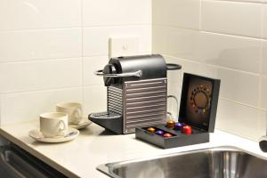 A kitchen or kitchenette at Mercure Melbourne Therry Street